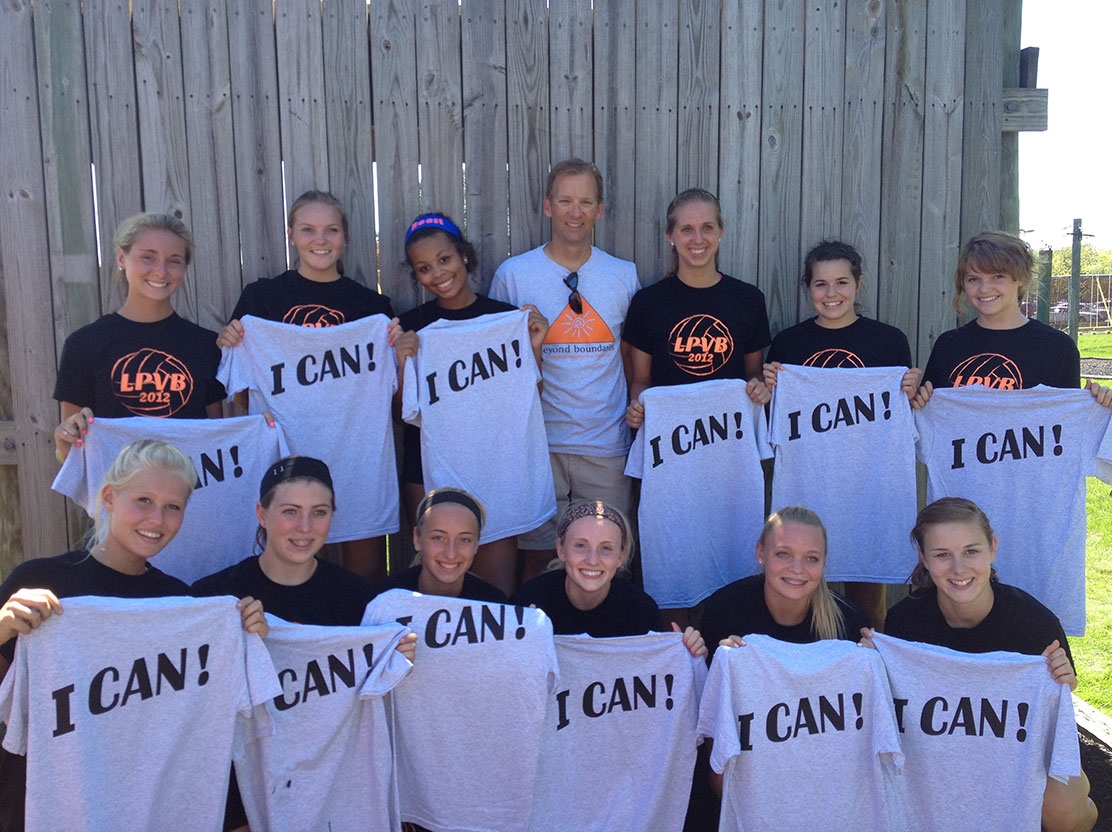 A local sports team poses with Beyond Boundaries Challenge Course Shirts.